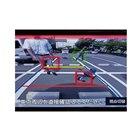 パーキングアシスト「カメラ機能拡張BOX」(BSG17)を使用したときのリアビュー画面。予測した進行方向の中に障害物を検知すると色付きの枠が出てドライバーに注意を喚起する。