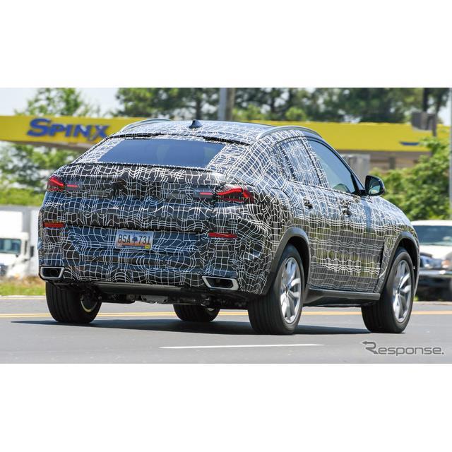 BMWのフラッグシップ・クーペSUV『X6』次期型プロトタイプが突如、軽カモフラージュ姿で出現した。  むき...