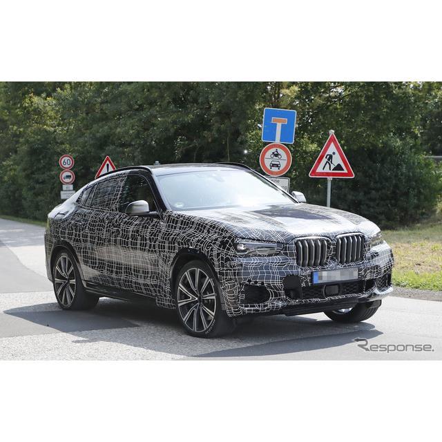 BMWの旗艦クーペSUV『X6』新型プロトタイプを、カメラが鮮明に捉えた。走行シーンに加え、今回は輸送中の様...