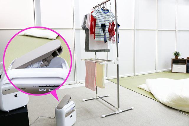 部屋干し中の洗濯物に送風する時は、送風口だけ引き出して運転します